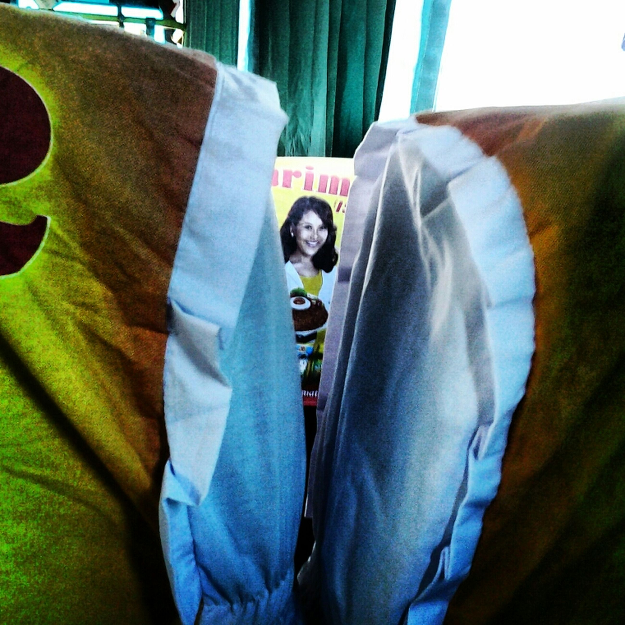 indoors, casual clothing, lifestyles, front view, bed, fabric, jeans, warm clothing, home interior, close-up, leisure activity, looking at camera, textile, relaxation, sitting, portrait, day, men