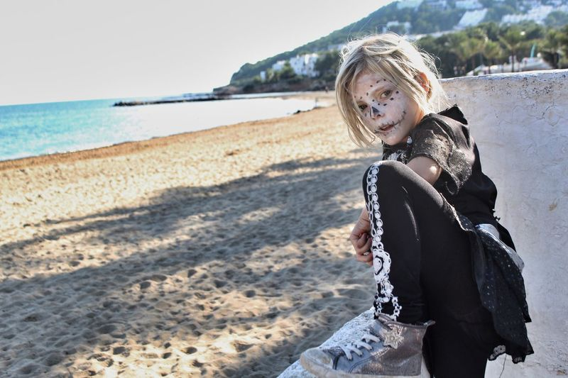 Girl With Facepaint On Beach