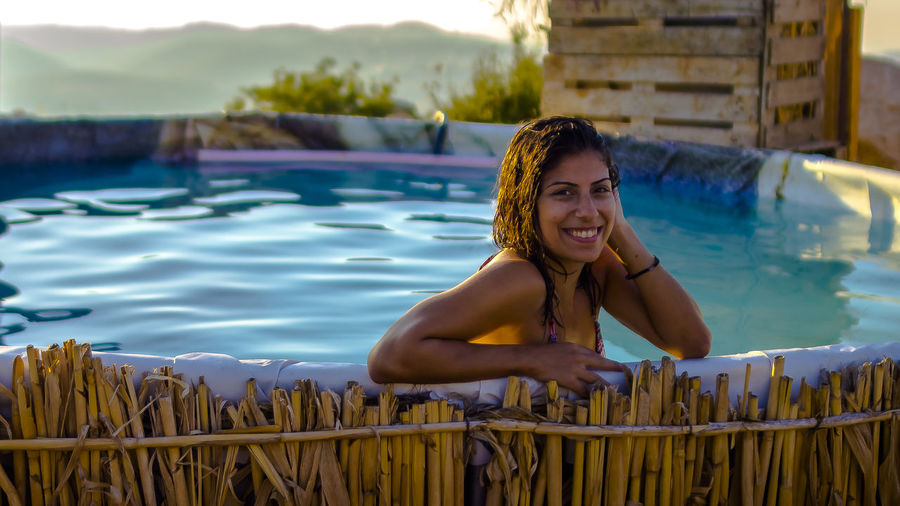 Portrait of happy woman in swimming pool