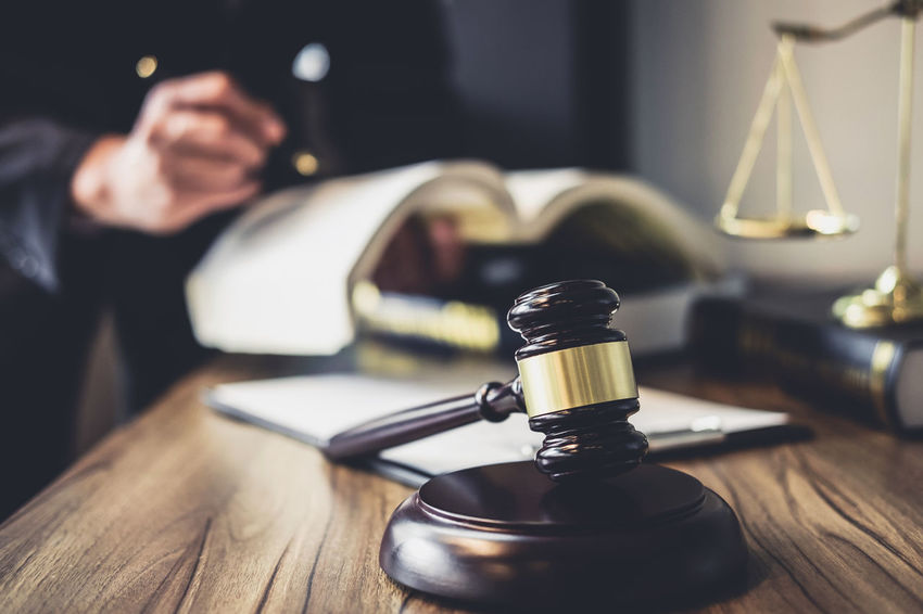 Lawyer Adult Balance Barrister Counselor Fairness Focus On Foreground Gavel Hand Holding Human Body Part Human Hand Indoors  Inheritance Judge Judgement Justice Legal Legislation Men Occupation One Person Selective Focus Verdict Wood - Material