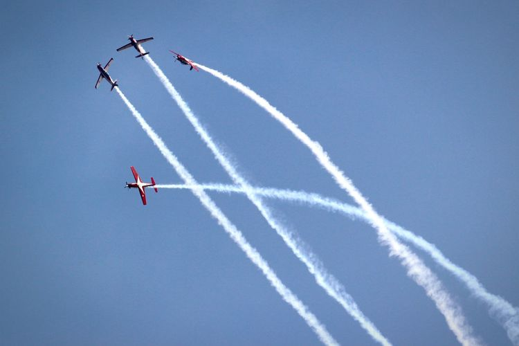 Low angle view of airshow against sky