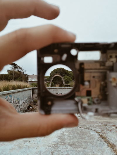 Midsection of person holding camera