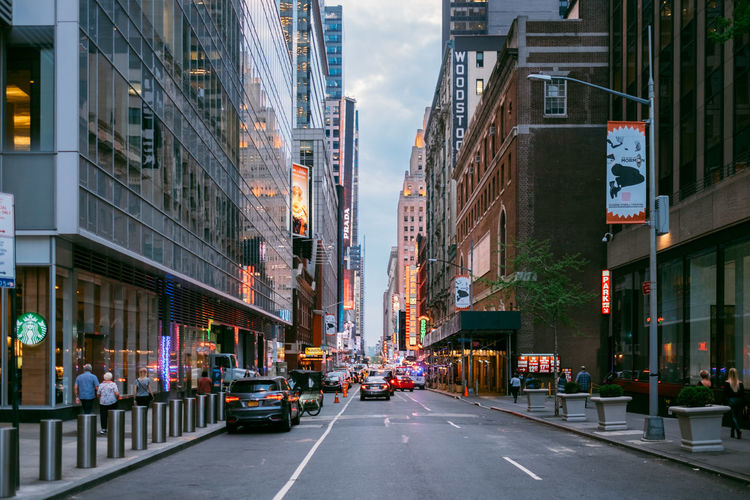 City Architecture Transportation Built Structure Building Exterior Mode Of Transportation Car Motor Vehicle Street Building Road Land Vehicle Incidental People Sign City Street City Life Outdoors Direction Day The Way Forward Busy Office Building Exterior