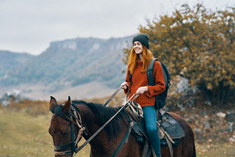 Portrait of young woman riding horse