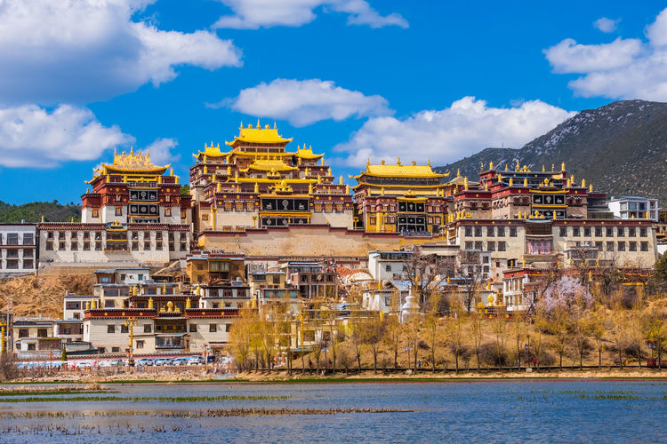 Architecture Built Structure Building Exterior Water Sky Nature Cloud - Sky Building The Past History No People Day Travel Destinations City Waterfront Travel Outdoors River Tourism Shangrila Shangri-La Yunnan China Tibet Temple Religion Architecture UNESCO World Heritage Site Beautiful