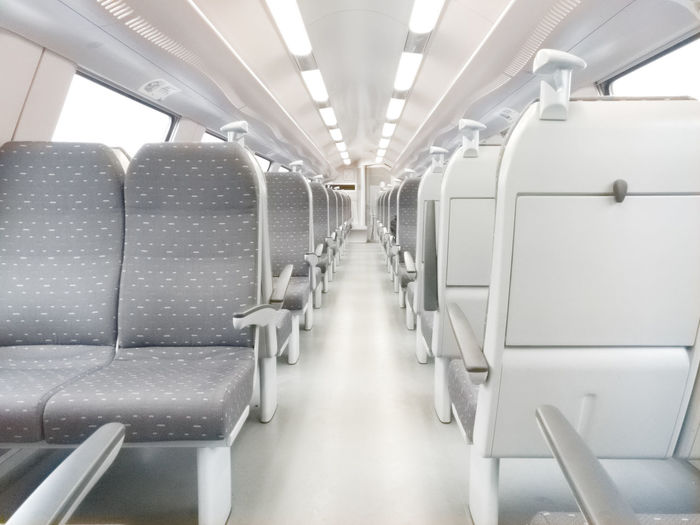 Empty interior of a modern railway carriage Carriage Day Empty Futuristic Illuminated Indoors  Modern No People Passenger Cabin Train Transportation Travel Vehicle Interior Vehicle Seat