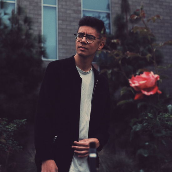the rose EyeEmNewHere EyeEm Best Shots Streetphotography Streetwear Fashion Photography Streetwearfashion City Men Portrait Standing Elégance Warm Clothing Front View Handsome Mid Adult Suave Posing Thoughtful