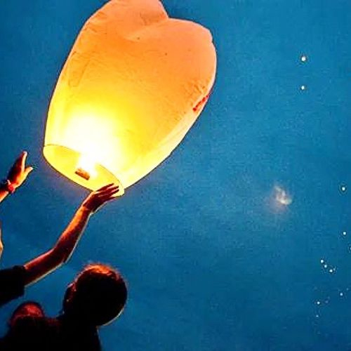 Adult Adults Only Balloon Blue Celebration Close-up Flying Happiness Hot Air Balloon Human Body Part Human Hand Multi Colored Night Outdoors People Releasing Sky Traditional Festival