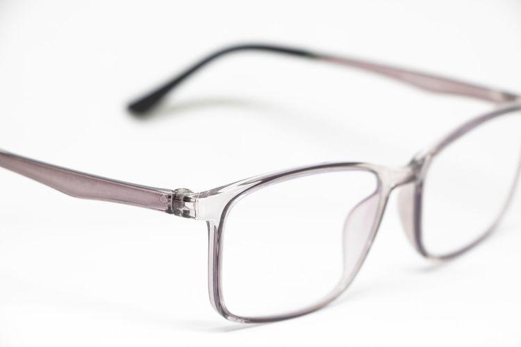 Close-up of eyeglasses against white background