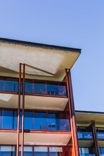 Low Angle View Architecture Built Structure Building Exterior Blue Sky Clear Sky Building No People Day Nature Copy Space Window Outdoors Glass - Material Modern Sunlight Residential District City Yellow Business Modern Modern Architecture