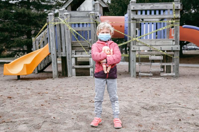 Full length of girl standing on playground