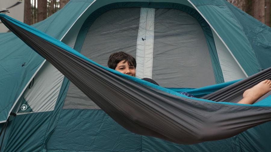 Portrait of boy lying in hammock
