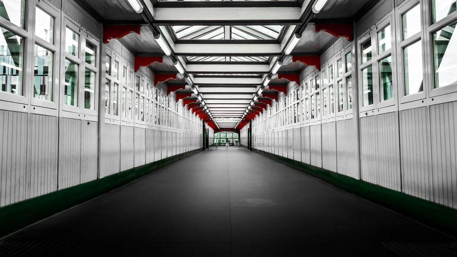 Illuminated corridor of modern building