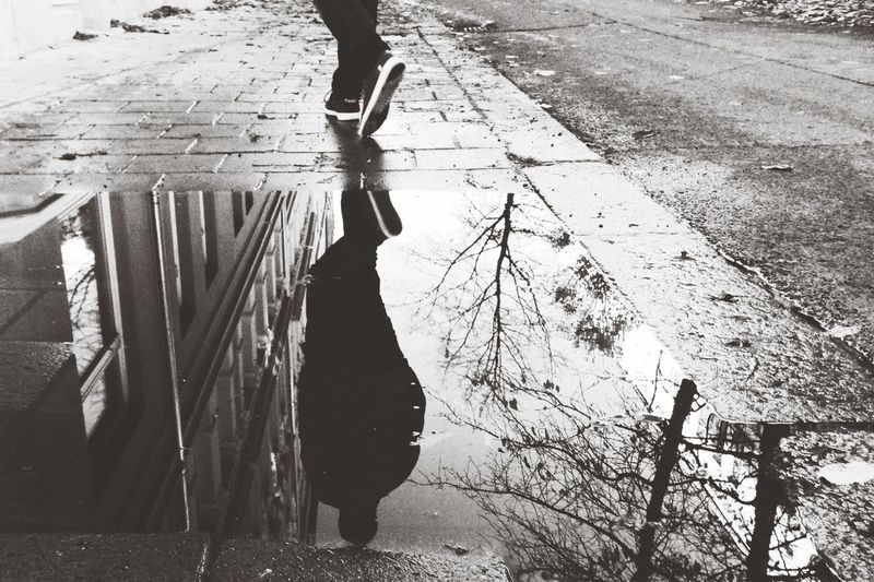 Silhouette of person standing in alley