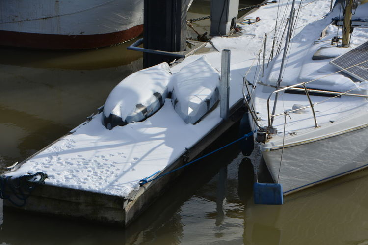 High angle view of sailboats moored in lake