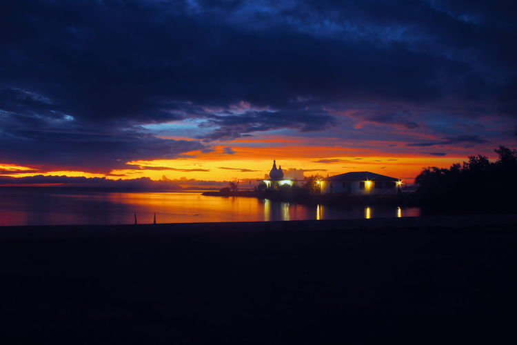 Trinidad And Tobago Water Sea Sunset Astronomy Reflection Sky Architecture Building Exterior Built Structure Silhouette Dramatic Sky Outline Seascape Moody Sky Ocean Shore