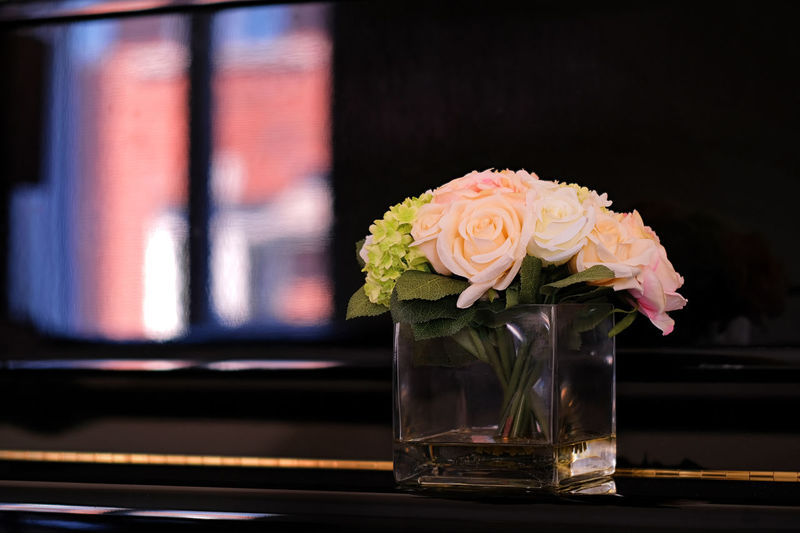 Close-up of rose bouquet in glass vase on table