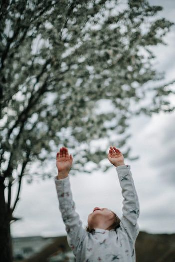 Spring celebration One Person Human Body Part Standing Outdoors Tree Human Arm Day Hand Raised One Man Only Mature Adult Human Hand Real People Only Men Adults Only People Close-up Men Nature Sky Adult