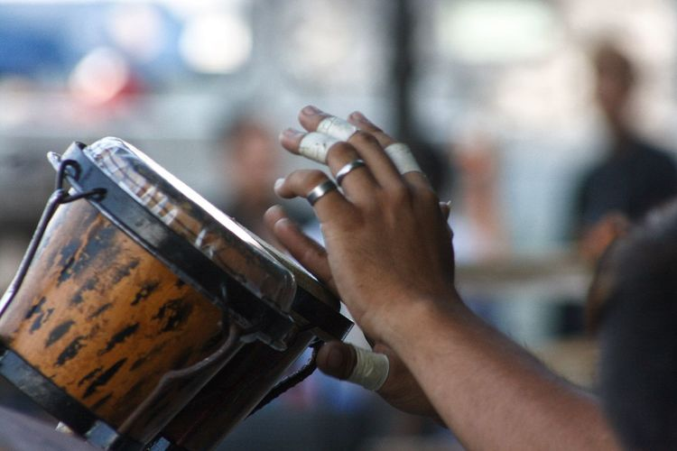 Cropped hands of musician playing instrument