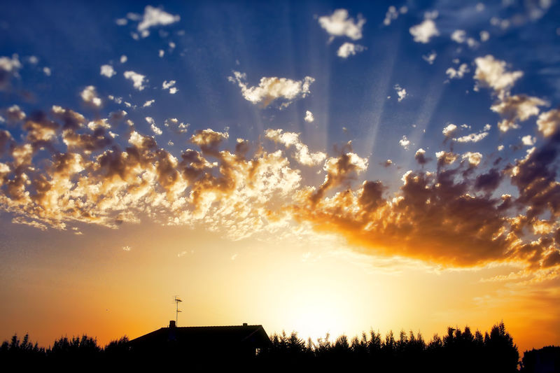 Certe Sere Sky Cloud - Sky Silhouette Sunset Beauty In Nature Scenics - Nature Nature Orange Color Tranquil Scene Sunlight No People Building Exterior Tree Built Structure Low Angle View Sun Outdoors