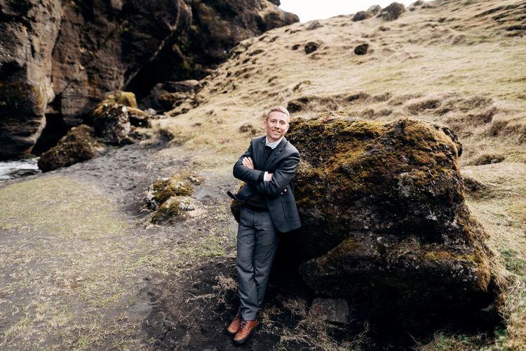 Portrait of man standing on rock