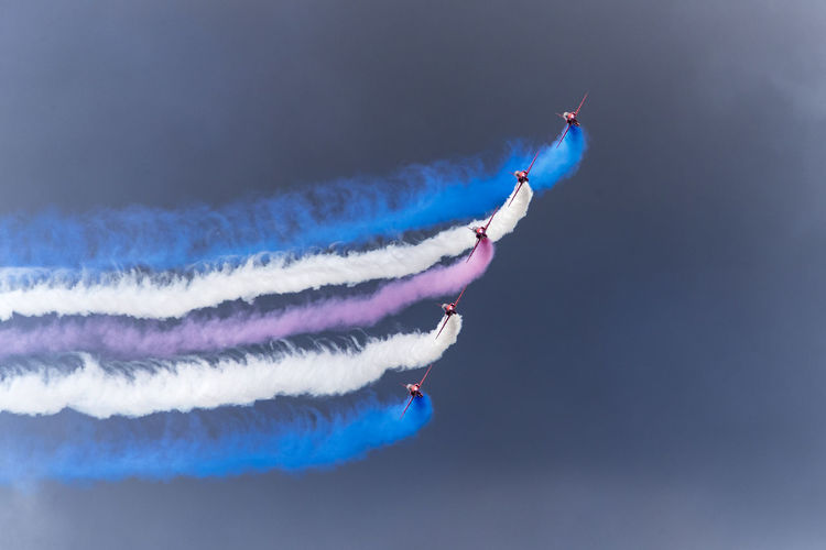 Airshow with multi colored vapor trails