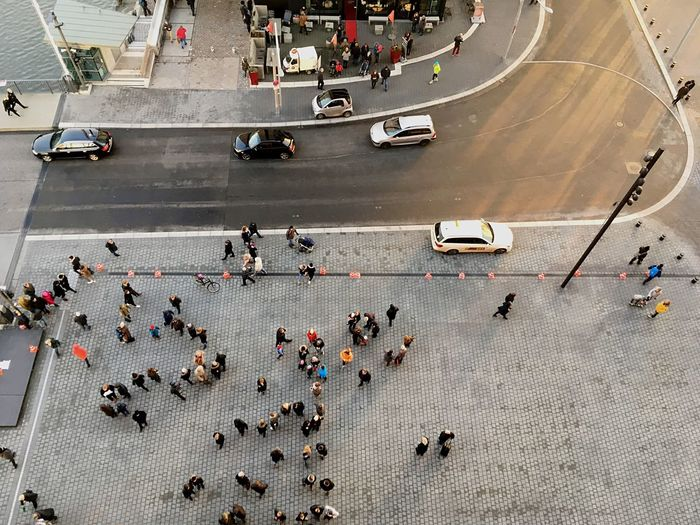 High Angle View Of People On Road In City