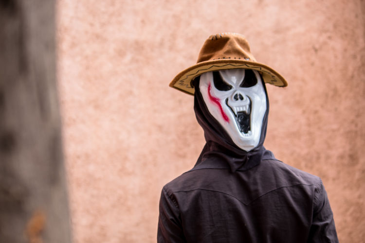 Halloween Adult Clothing Disguise Emotion Fear Fun Halloween Headshot Hiding Horror Human Body Part Looking At Camera Mask Mask - Disguise Obscured Face One Person Portrait Spooky Unrecognizable Person Urban Fashion Jungle