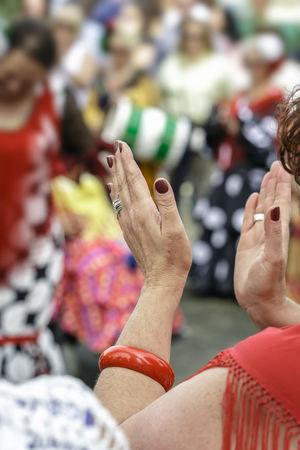 Spanish woman dressed in flamenco, dancing and clapping her hands in Seville Fair. Close up. Selective focus. April Beautiful Dance Dress Flamenco Hands SPAIN Sevilla Seville Spanish Woman Clap Clapping Culture Dancer Enjoying Life Fair Fan Female Feria De Abril Festival Folk Folklore Traditional Women