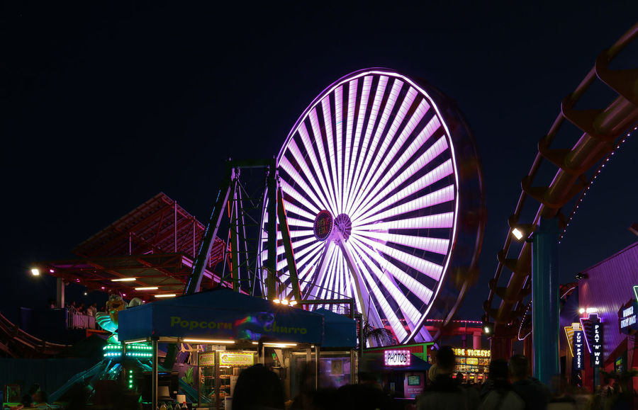 Neon Evening - Amusement Park Amusement Park Ride Architecture Arts Culture And Entertainment Built Structure City Crowd Ferris Wheel Illuminated Leisure Activity Lifestyles Low Angle View Multi Colored Neon Night Nightlife Outdoors Sky
