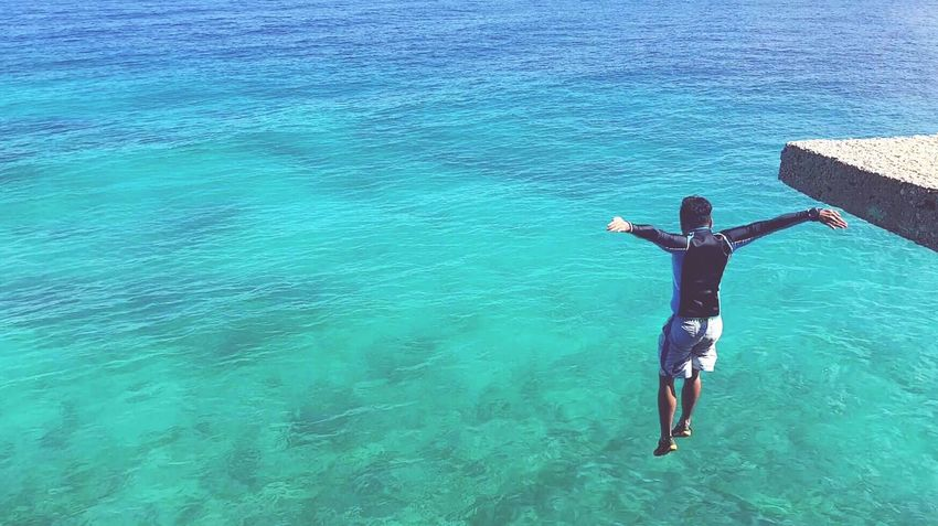 Sea Water High Angle View Leisure Activity Full Length Real People Day Adventure One Person Lifestyles Men Outdoors Scuba Diving Nature Blue Vacations Scenics Only Men One Man Only Beauty In Nature Cliff Jumping Cliff Edge Cliff Guts People EyeEmNewHere The Great Outdoors - 2017 EyeEm Awards