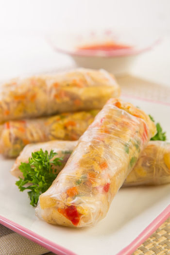 Close-Up Of Spring Rolls Served In Tray