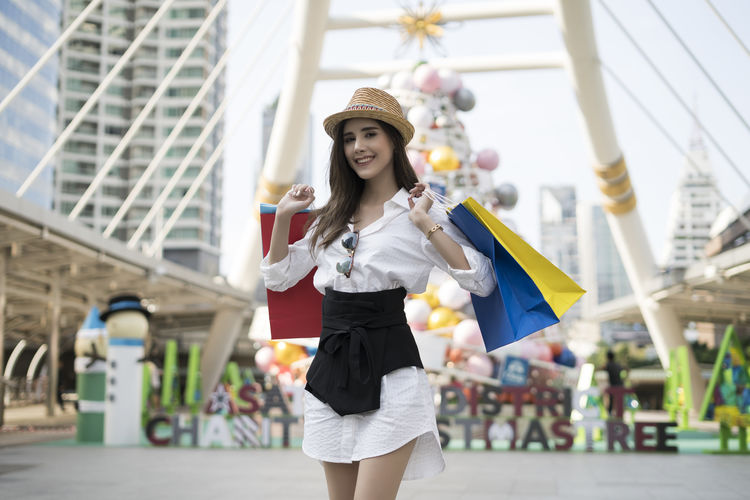 Lady in shopping. Happy lady with shopping bags enjoying in shopping. Consumerism, shopping, lifestyle concept Shopping Shopping Mall Shopping Time Holding Consumerism Shopping Bags Lifestyle Enjoying Life Urban Caucasian Caucasian Girls Lady Attractive Attractive Female Cheerful Customer  Holidays Purchases Sale Spending Presents