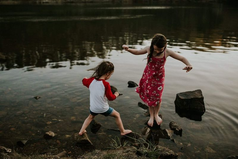 Cousin fun. Two People Full Length Childhood Child Bonding Togetherness Girls Females Enjoyment Leisure Activity Fun Outdoors Motion Water Nature People Day Adult
