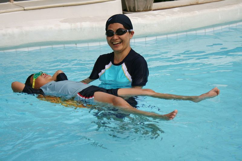 Asianboy Asianwoman Mother And Son Love Togetherness Two People Play Time EyeEm Selects Sunglasses Swimming Pool Smiling Water Happiness Vacations Leisure Activity Portrait Day Looking At Camera Enjoyment