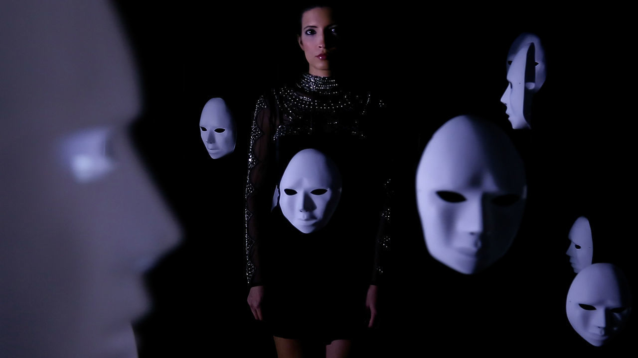 representation, human representation, indoors, art and craft, no people, creativity, mask, toy, disguise, mask - disguise, female likeness, male likeness, close-up, craft, dark, focus on foreground, figurine, studio shot, mannequin, black background