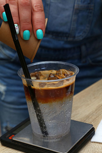 Woman hand of barista making iced coffee in plastic cup Espresso Woman Barista Close-up Coffee - Drink Coffee Cup Cold Beverages Cold Drink Day Drink Drinking Glass Drinking Straw Food And Drink Freshness Human Hand Iced Coffee People Real People Refreshment Table Focus On The Story