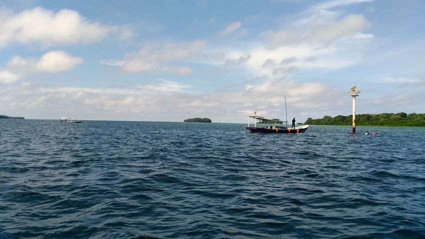 Sea view #water #view #beach #Nature  #Island #Indonesia #pulauseribu #journey #scenery Nautical Vessel Sea Sailing Oil Pump Fuel And Power Generation Sky Horizon Over Water Cloud - Sky Landscape Sailing Ship Seascape Calm Sailboat Waterfront