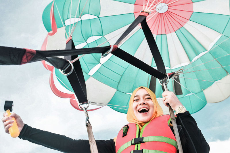 Happiness Emotion Leisure Activity Mouth Open Lifestyles Front View Smiling Positive Emotion Enjoyment Excitement Portrait Outdoors Innocence Paragliding Adventure Vlogging Gopro Langkawi Island Malaysia Woman In Hijab Vertigo Vacation International Women's Day 2019