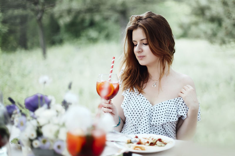 Beautiful woman sitting on table