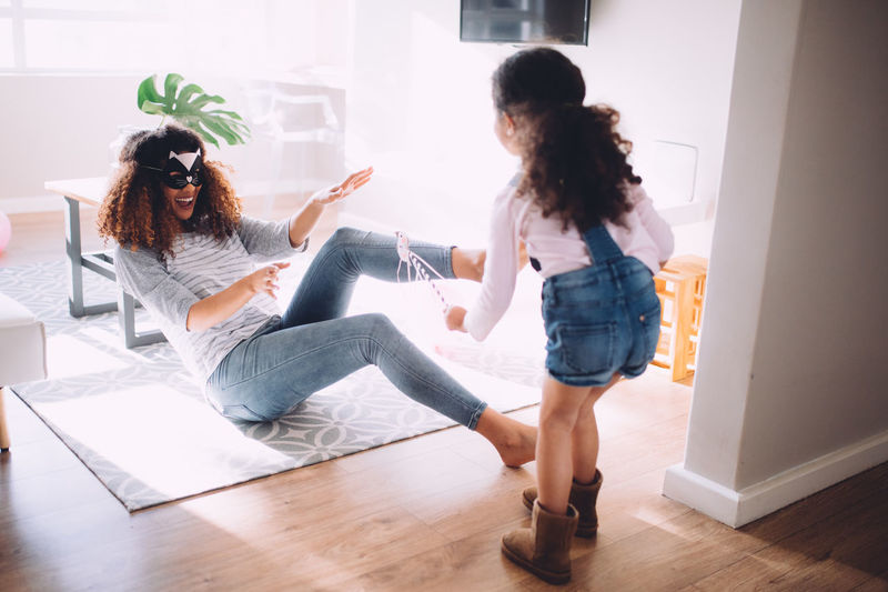 Mother and daughter playing with props at home