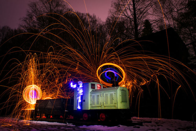 Wire Wool Over Train Against Trees At Night