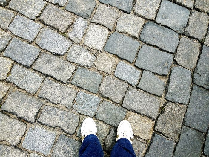 High Angle View Low Section Shoe Human Leg Day Outdoors Standing Full Frame Human Body Part One Person EyeEm LOST IN London Tiles Architecture Tiled Floor People Standing Architecture City Modern Floor Shoes Brickstones Bricks Retro Stone An Eye For Travel