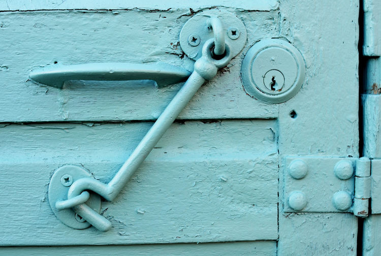 Close-Up Of Latch Hanging On Door