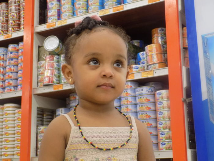 Beautiful Hope Innocence Life Supermarket A Look Into The Future Angle Childhood Choice Close-up Cute Cute Girl Day Girl Indoors  Infinitypool Kidsphotography Lovely Necklace One Person Photography Real People Shelf Standing The Magic Of Eye