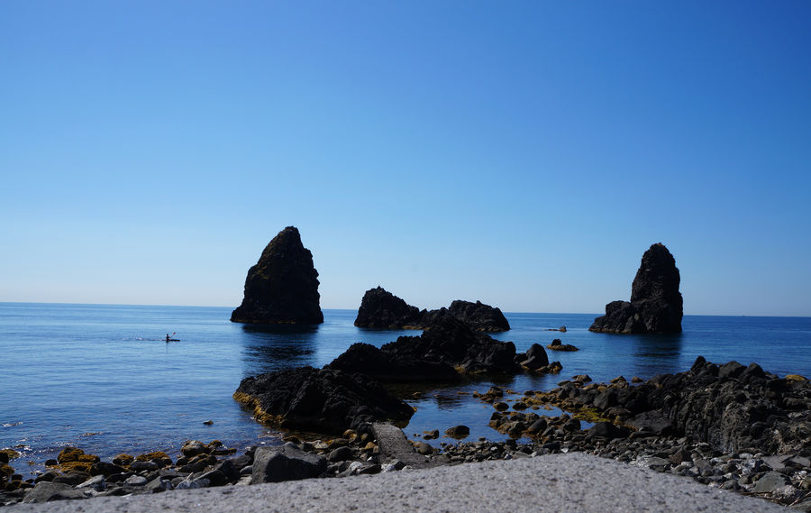 Catania, Sicily Cyclops' Coast Sicily, Italy Sicily's Riviera Dei Ciclopi Beach Beauty In Nature Blue Clear Sky Day Horizon Over Water Nature No People Outdoors Riviera Dei Ciclopi Rock Rock - Object Rock Formation Scenics Sea Sky Tranquil Scene Tranquility Water