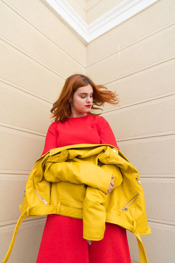 The Fashion Photographer - 2018 EyeEm Awards Beauty Clothing Contemplation Front View Hairstyle Looking One Person Real People Red Hair Women Yellow Young Adult
