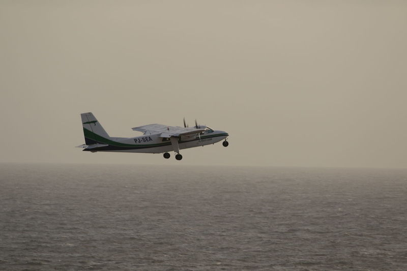 Air Vehicle Airplane Britain Norman Islander Caribbean Sea Day Flying Mid Air No People Outdoors Over Sea Over Water Propeller Airplane Sky Transportation Twin Engine