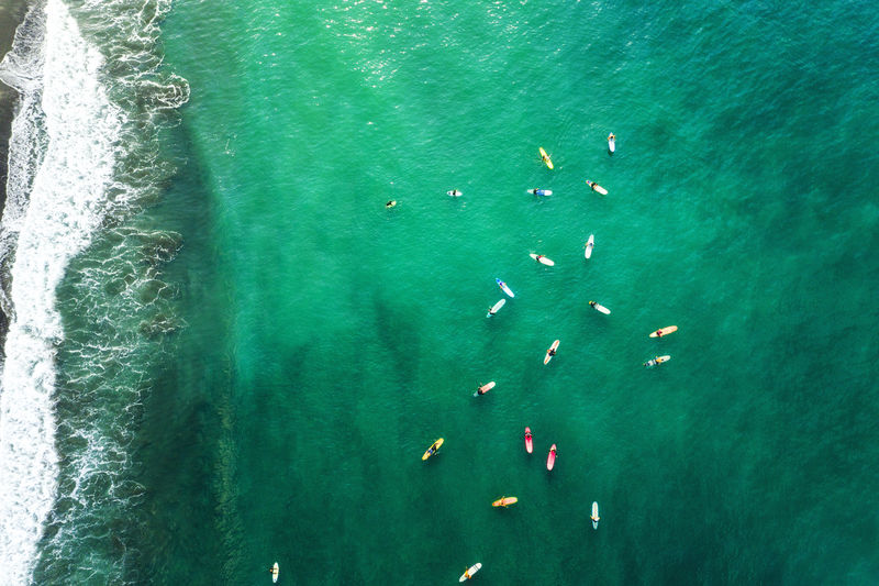 Water Sea Turquoise Colored Nature Beauty In Nature Day High Angle View Motion Nautical Vessel Sunlight Outdoors Swimming Group Of People Green Color Real People Unrecognizable Person Waterfront Leisure Activity
