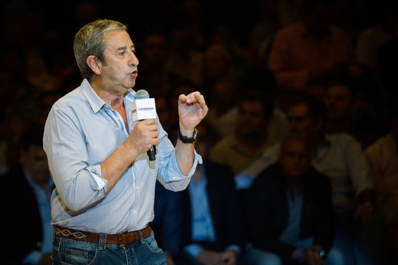 """ARGENTINA, Cordoba: Julio Cobos, political and elect National Deputy of us change opposition ('Let's change """") party, speaks to supporters at a final campaign rally in Cordoba, Argentina on October 22, general elections 2015 in Argentina will take place on 25 October. Cambiemos Camping Candidate Color Image Election Horizontal Indoors  Julio Cobos Photo Political President Real People Selective Focus Young Adult"""